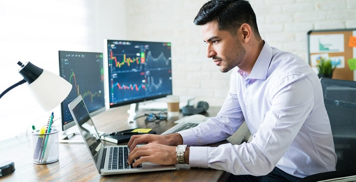 market research analyst seated at desk, working on computer